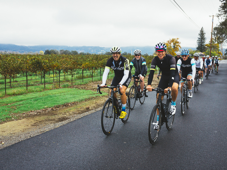 Andy Levine cycling by Sonoma, California vineyard