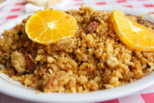 Migas con cachitos de lomo y pancetta, adornadas con rodajas de naranja.  Buenisimo.  Tomada durante una comida fantastica en una venta en los montes de Malaga.  I take photos for fun and for my business blog (Say No! to the Office), food company website (The Tapas Lunch Company) and Spanish food portal (Spanish Food World).  Copyright © 2011 Jonathan Pincas.  All Rights Reserved. Please contact me if you're interested in using one of my pictures.