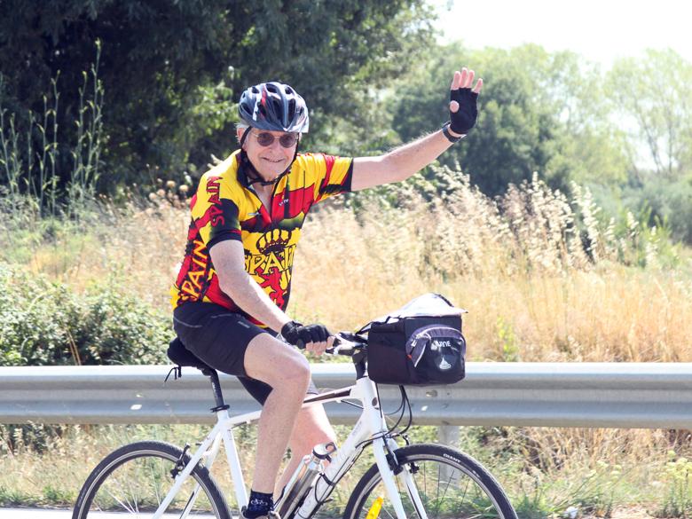 Older cyclist rides an e-bike in Costa Brava, Spain