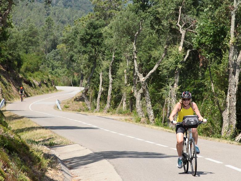 Woman conquering incline in Costa Brava, Spain on an e-bike