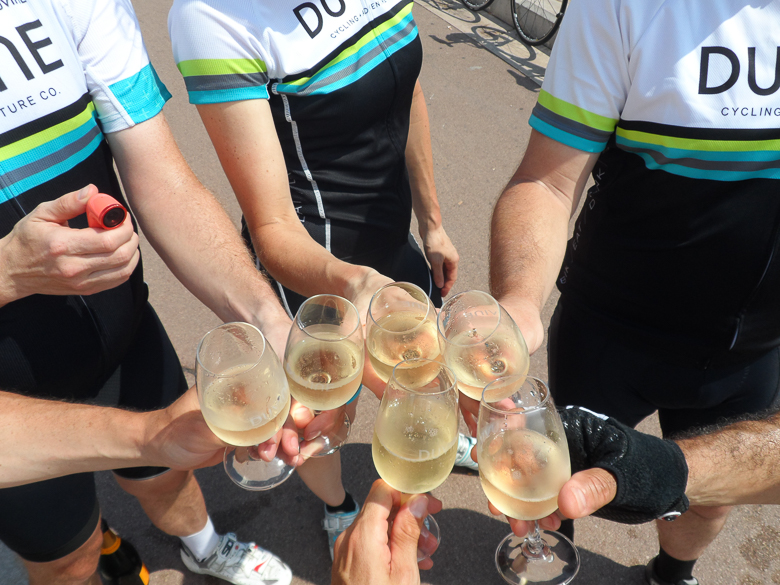DuVine cyclists toasting with sparkling wine