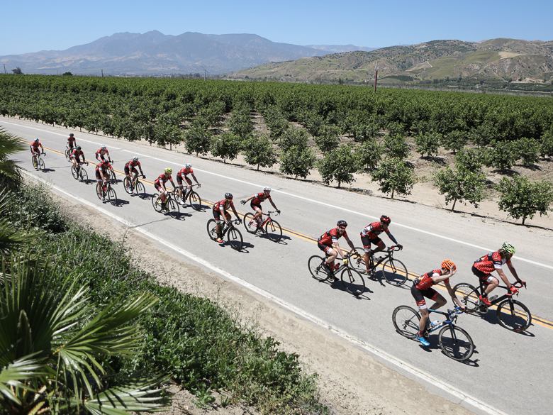 Cyclists riding for Red Nose Day roll through a California landscape