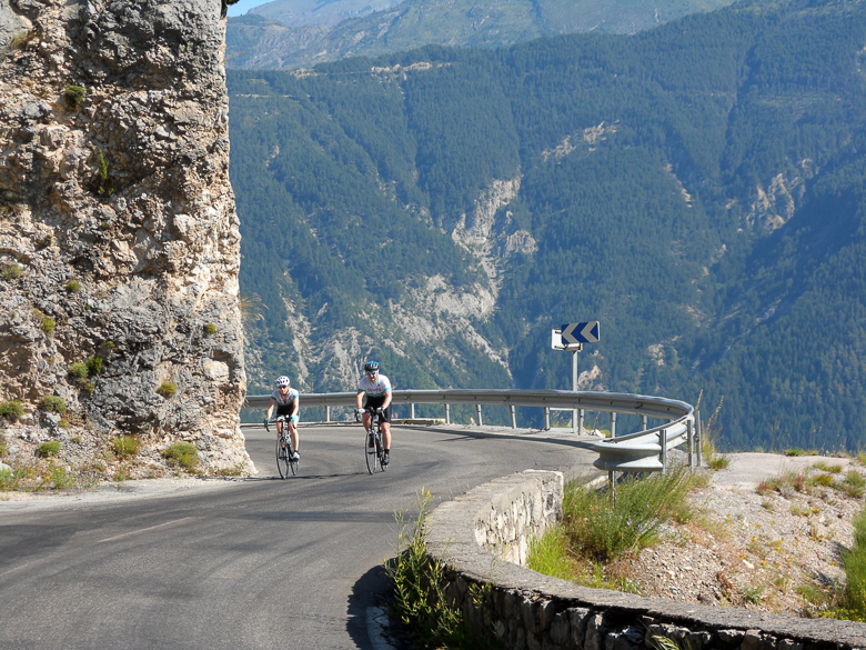 Cyclists on a balcony on Col de la Cayolle in the Alps