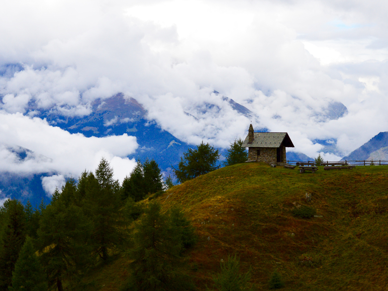 Standalone house in the clouds on Mortirolo in the Dolomites, Italy