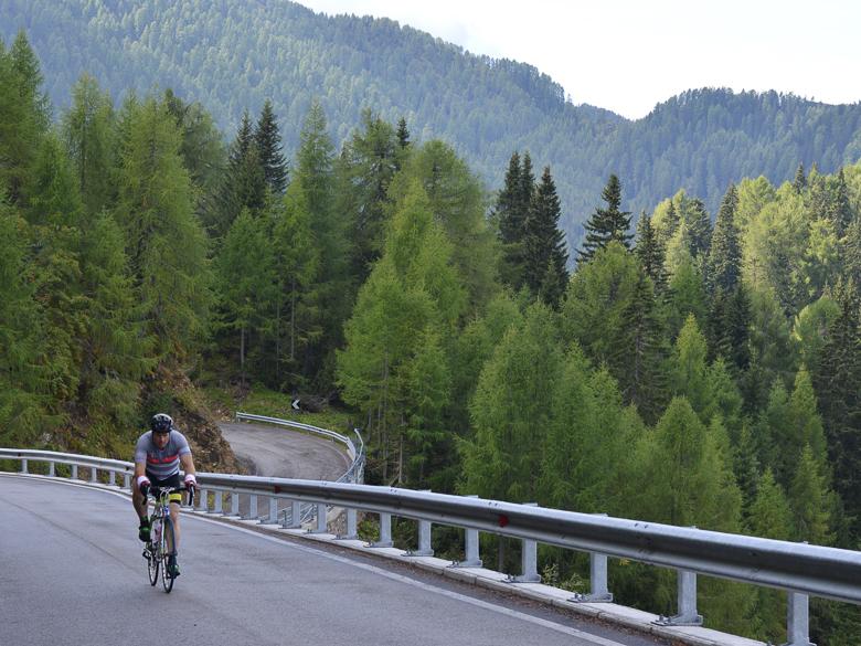 Cyclist riding on Sella Ciampigotto in the Dolomites, Italy