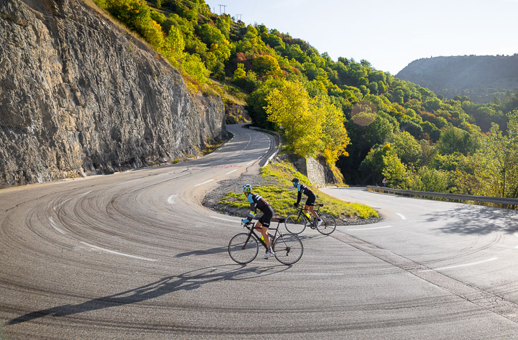 Two people cycling in the French Alps on a DuVine Bike Tour
