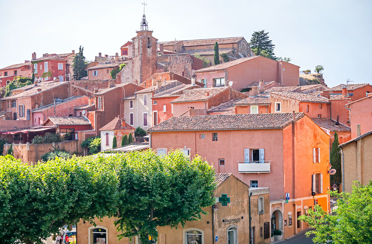 Red-orange buildings on a hillside in the village of Roussillon, Provence, France