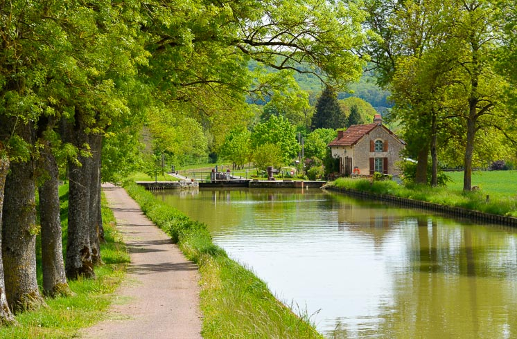 A bike path runs along a canal in the Ouche valley of Burgundy