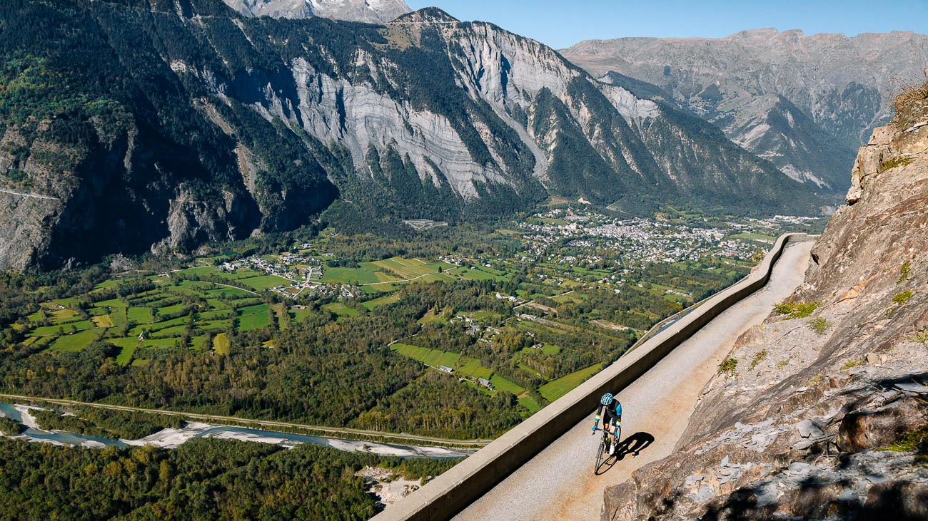 A person cycling in the French Alps on a DuVine Bike Tour