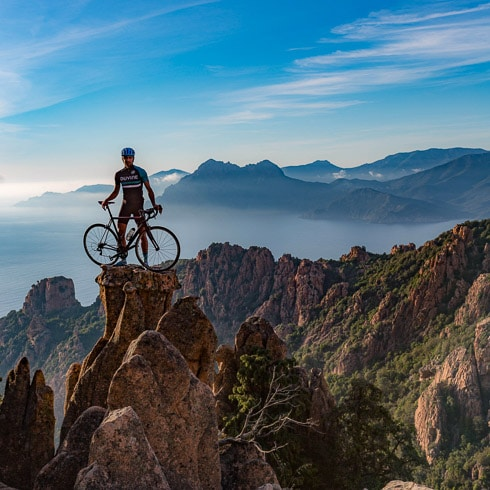 DuVine cyclist on top of mountain in Corsica, France