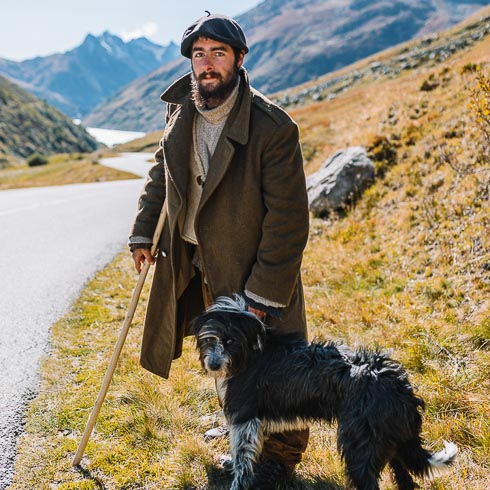 Local French shepherd and his dog in the French Alps