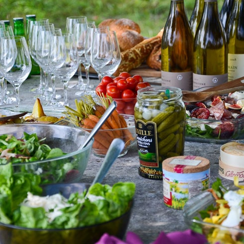 A DuVine-style picnic lunch of salad, cornichons, Chardonnay, and tomatoes