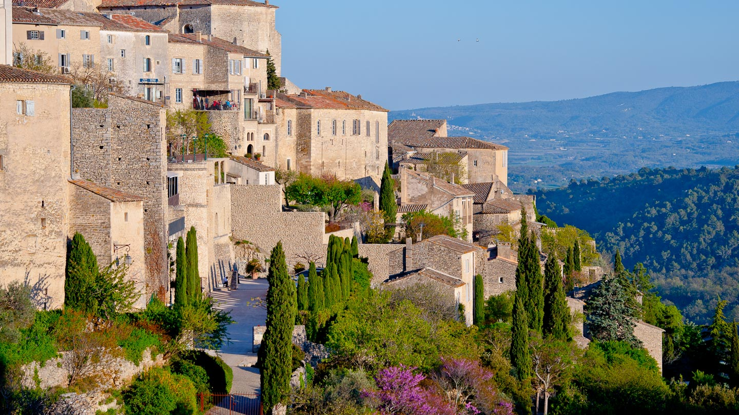 The sentinel village of Gordes in Provence, France with mountains in the distance