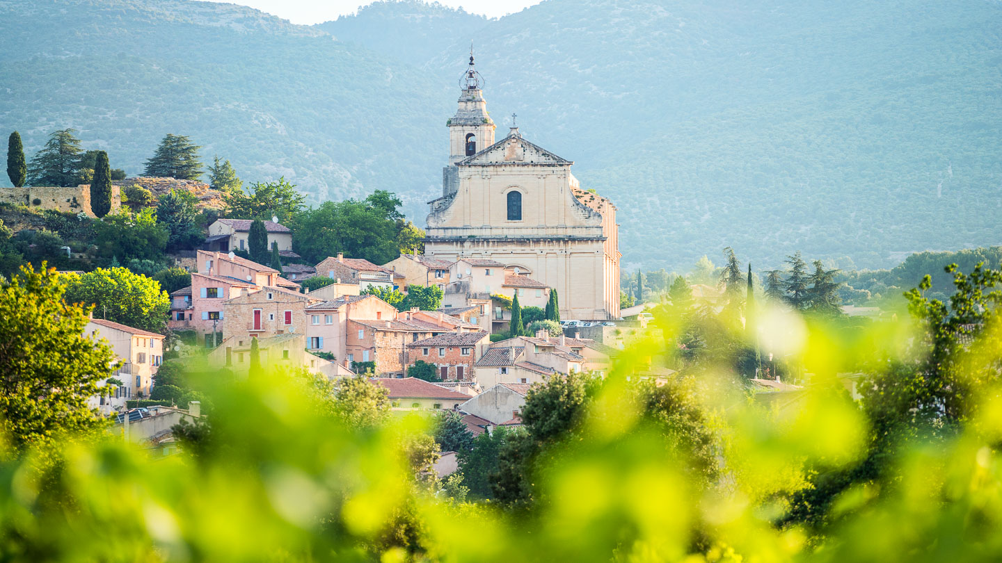 Landscape of church with ornamental bellow tower in the village of Bedoin, Provence, France