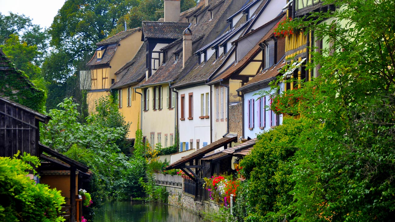 Riverfront houses surrounded by greenery in Strasbourg, France