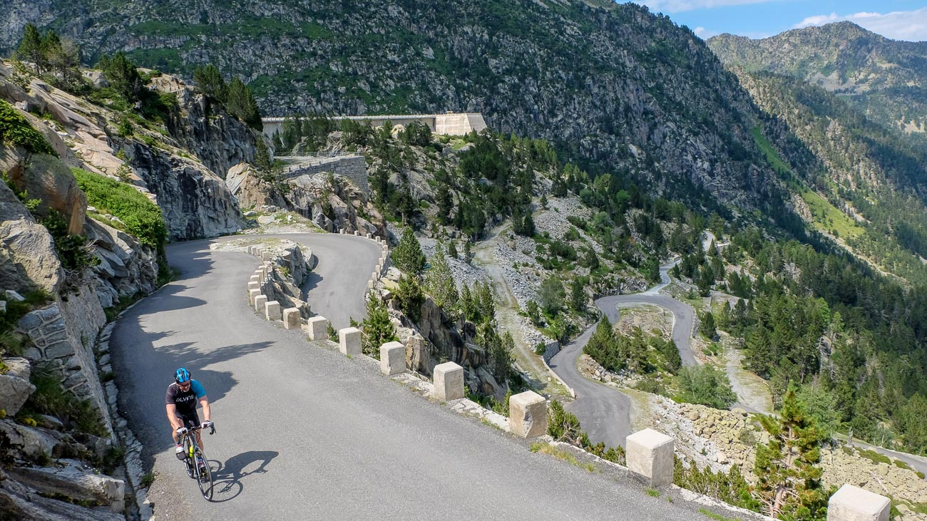 A DuVine cyclist finishing a switchback on the Col du Tourmalet pass in the French Pyrenees