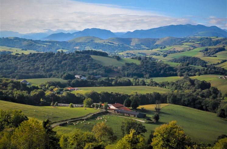 Rural landscape with a farm in a valley of the Pyrenees mountains