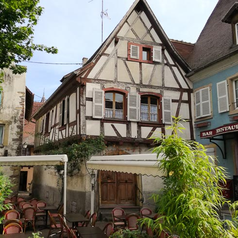 Charming half-timbered cafe in a village of Alsace, France