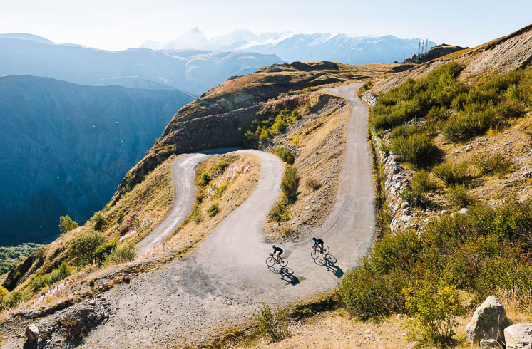 Two DuVine cyclists riding a col in the French Alps