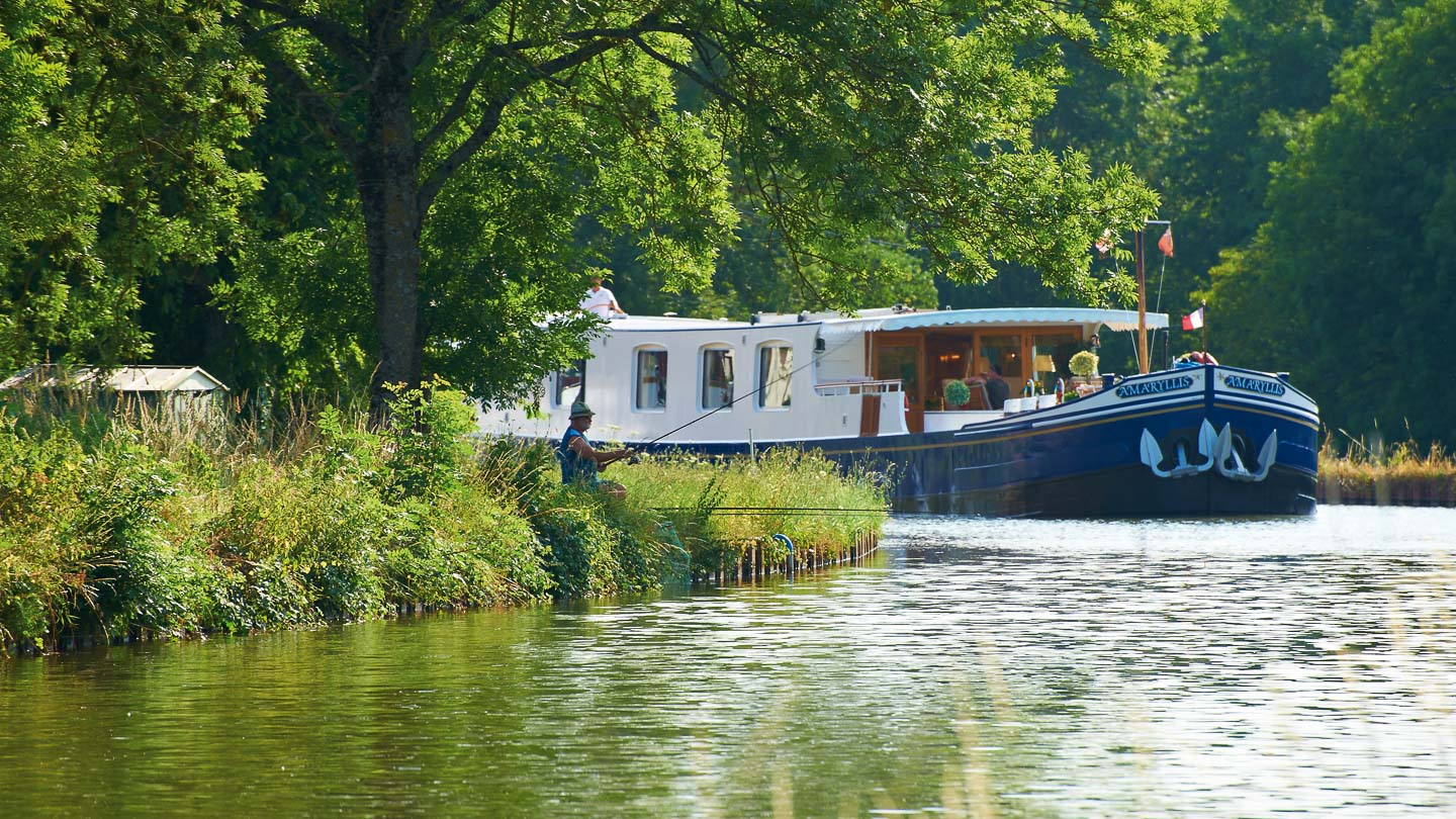 The river cruise boat Belmond Amaryllis sailing on the Burgundy Canal