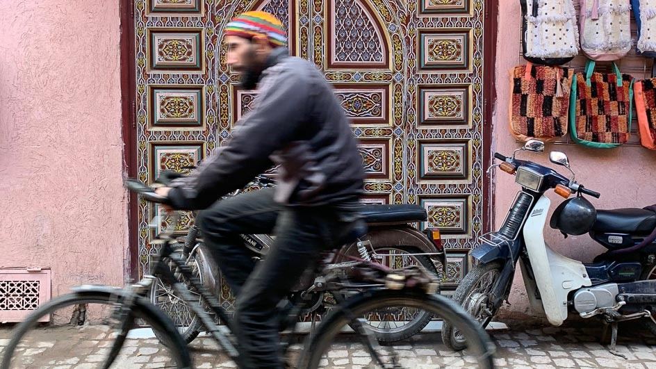 Local man cycling in Marrakesh, Morocco
